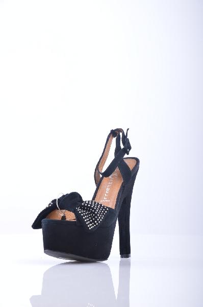 Сандалии JEFFREY CAMPBELLЖенская обувь<br>Замша, аппликации из металла, бант, одноцветное изделие, ремешок на щиколотке, скругленный носок, резиновая подошва, обтянутый каблук.<br>Высота каблука: 17 см.<br>Высота платформы: 5.5 см<br>Страна: США<br><br>Высота каблука: 17 см<br>Высота платформы: 5.5 см<br>Материал: Натуральная кожа<br>Сезон: ЛЕТО<br>Коллекция: Весна-лето<br>Пол: Женский<br>Возраст: Взрослый<br>Цвет: Черный<br>Размер RU: 37