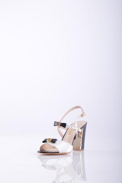 Босоножки, KliminiЖенская обувь<br>Описание: Прекрасные босоножки с открытым мыском. Модель выполнена из высококачественного материала приятной расцветки. Отличный вариант для повседневного использования. <br><br>Материал подкладки: натуральная кожа. <br><br><br>Материал верха: Кожа<br><br><br>Материал подкладки: Кожа<br><br><br>Форма мыска: Закругленный мысок<br><br><br>Декоративные элементы: Банты<br><br><br>Вид застежки: Пряжка<br><br><br>Форма каблука: Толстый<br><br><br>Особенность материала верха: Глянцевый<br><br><br>Высота каблука: 9.5 см.<br><br><br>Высота платформы: 0.3 см.<br><br><br>Страна: Россия<br><br>Высота каблука: 9.5 см<br>Высота платформы: 0.3 см<br>Материал: Натуральная кожа<br>Сезон: ЛЕТО<br>Коллекция: Весна-лето<br>Пол: Женский<br>Возраст: Взрослый<br>Цвет: Разноцветный<br>Размер RU: 38