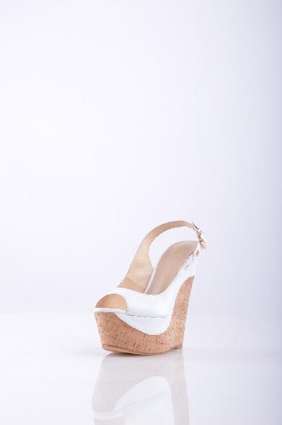 Босоножки, CVCoverЖенская обувь<br>Состав: натуральная кожа<br><br>Великолепные, лаковые босоножки не оставят равнодушной ни одну модницу. Модель на высокой пробковой танкетке и платформе. Изделие с застежкой на металлическую пряжку. Материал подкладки: натуральная кожа.<br>Высота каблука: 16 см...<br><br>Высота каблука: 16 см<br>Высота платформы: 5 см<br>Материал: Натуральная кожа<br>Сезон: ЛЕТО<br>Коллекция: (Справочник &quot;Номенклатура&quot; (Общие)): Весна-лето<br>Пол: Женский<br>Возраст: Взрослый<br>Размер RU: 38