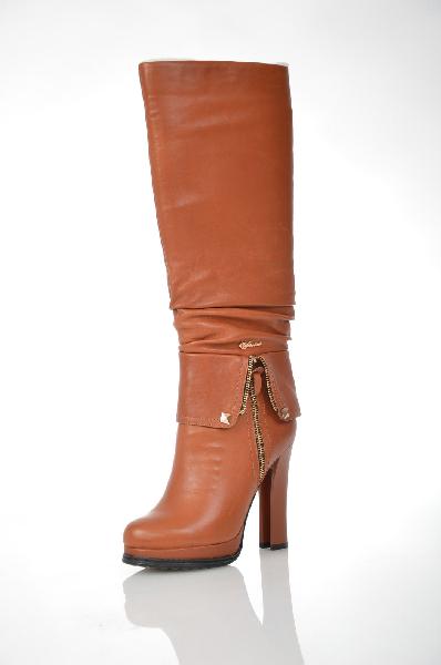 Сапоги VitacciЖенская обувь<br>Цвет: рыжий<br> Материал верха: натуральная кожа<br> Материал подкладки: текстиль<br> Материал подошвы: ПУ<br> Параметры изделия: для размера 37/37: высота платформы 2,7 см, ширина носка стельки 8 см, обхват голенища 35 см<br><br>Объем голени: 35 см<br>Материал: Натуральная кожа<br>Сезон: ВЕСНА/ОСЕНЬ<br>Коллекция: Осень-зима<br>Пол: Женский<br>Возраст: Взрослый<br>Цвет: Красно-коричневый<br>Размер RU: 37