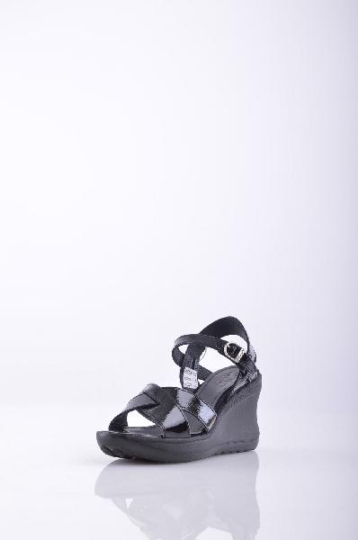 RUCO LINE СандалииЖенская обувь<br>Описание: эффект лакировки, логотип, одноцветное изделие, пряжка, скругленный носок, резиновая подошва с тиснением, каблук из резины.<br>Высота каблука: 9 см.<br>Высота платформы: 2 см.<br>Страна: Италия<br><br>Высота каблука: 9 см<br>Высота платформы: 2 см<br>Материал: Натуральная кожа<br>Сезон: ЛЕТО<br>Коллекция: Весна-лето<br>Пол: Женский<br>Возраст: Взрослый<br>Цвет: Черный<br>Размер RU: 38