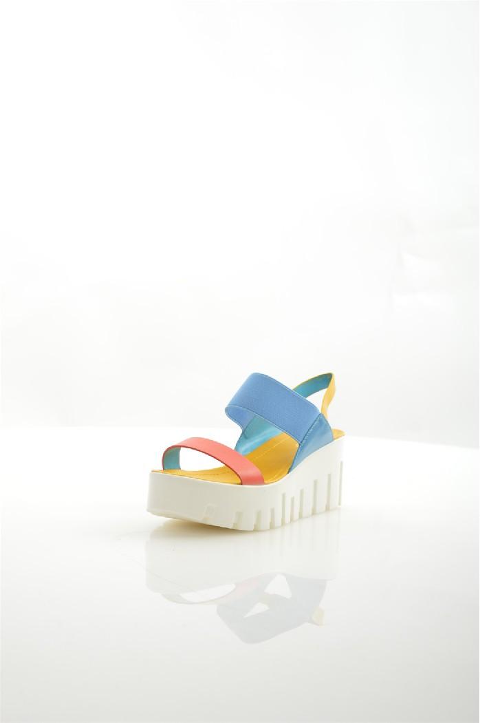Босоножки RIDLSTEPЖенская обувь<br>Цвет: коралловый, голубой, желтый<br> Материал верха: кожа искусственная, текстиль<br> Материал подкладки: кожа искусственная<br> Материал стельки: кожа искусственная<br> Материал подошвы: искусственный материал, рифлёная<br> Высота каблука: 7 см<br> Местоположение логотипа: стелька<br> Уход за изделием: протирать губкой<br> Параметры изделия: <br> для размера 37/37: высота платформы 3-6,5 см, ширина носка стельки 8,5 см, длина стельки 24,5 см<br> <br> Страна: Россия<br><br>Высота каблука: 7 см<br>Материал: Искусственная кожа<br>Сезон: ЛЕТО<br>Коллекция: Весна-лето<br>Пол: Женский<br>Возраст: Взрослый<br>Цвет: Разноцветный<br>Размер RU: 38