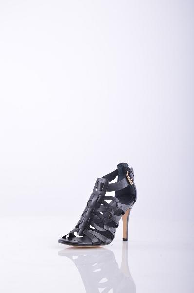Босоножки BRUNO PREMIЖенская обувь<br>Эффект ламинирования, Одноцветное изделие, Боковая пряжка, Скругленный носок, Без аппликаций, Резиновая подошва с тиснением, Обтянутый каблук-стилет.<br>Высота каблука: 9.5 см.<br>Страна: Италия<br><br>Высота каблука: 9.5 см<br>Материал: Натуральная кожа<br>Сезон: ЛЕТО<br>Коллекция: Весна-лето<br>Пол: Женский<br>Возраст: Взрослый<br>Цвет: Черный<br>Размер RU: 36