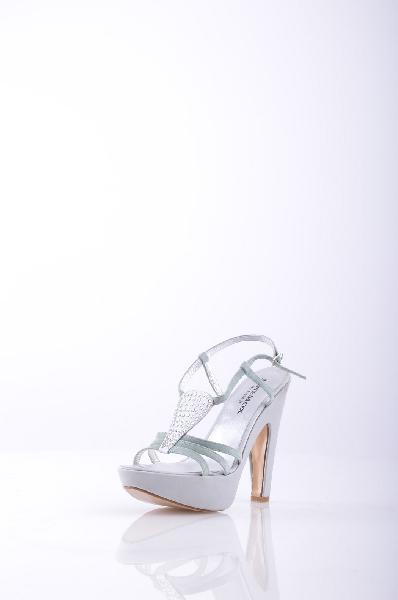 Босоножки JANEMOX by RIGHI JRЖенская обувь<br>Текстильное волокно, атлас, замша, одноцветное изделие, ремешок на щиколотке, скругленный носок, стразы, кожаная подошва, обтянутый прямой каблук. <br> <br> Высота каблука: 13 см. <br> Высота платформы: 3.5 см <br>Страна: Италия<br><br>Высота каблука: 13 см<br>Высота платформы: 3.5 см<br>Материал: Натуральная кожа<br>Сезон: ЛЕТО<br>Коллекция: (Справочник &quot;Номенклатура&quot; (Общие)): Весна-лето<br>Пол: Женский<br>Возраст: Взрослый<br>Цвет: Серый<br>Размер RU: 38